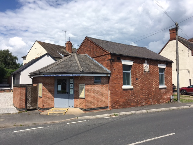 Front view of Weston on Trent  Wesleyan Methodist chapel. The added proch has replaced the original door which was between the two front windows. | Christopher Hill July 2021